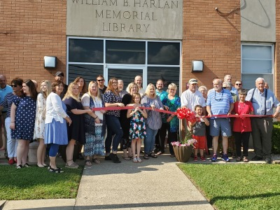 WBHML Director Monica Edwards cuts the ribbon to kick off our May 28th Open House.