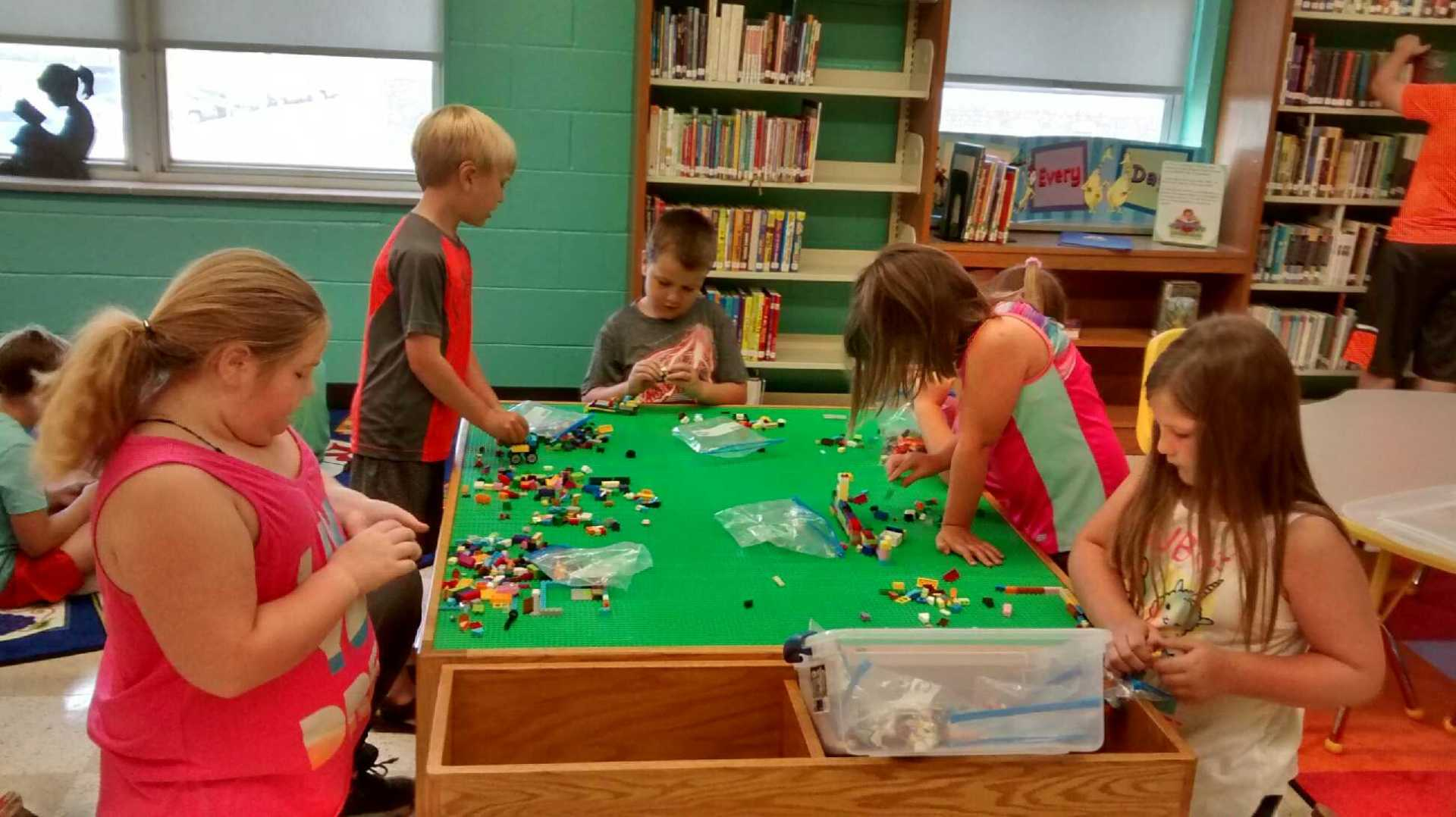 Morning campers take a break to build on our Lego table.
