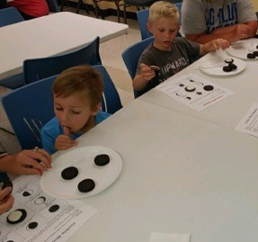 Learning phases of the moon in afternoon Summer Reading Camp.