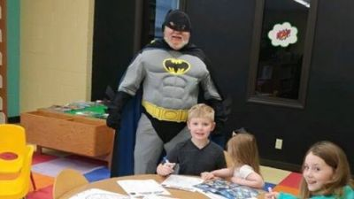 Batman oversees the activities during Free Comic Book Day.