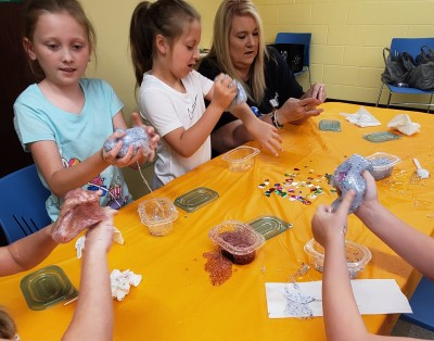 Making Galaxy Slime during the morning Summer Reading Day Camp.
