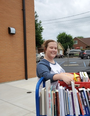 Student Assistant Abbie helps sort our book donation.