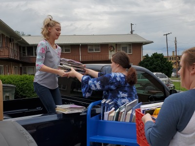 Our student assistants Danni, Abbie and Eternity unload donated books.